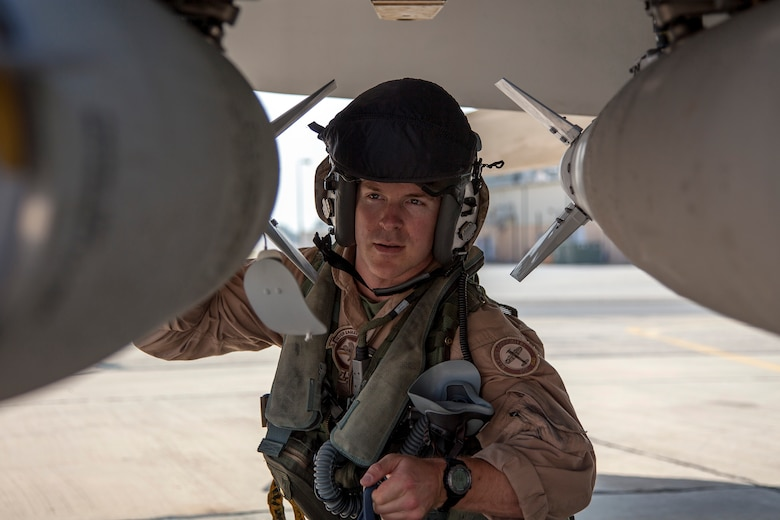 Marine Capt. Matthew Holcomb from the VMFA-115 squadron performs pre-flight checks on his F-18 aircraft prior to takeoff. The Marine Fighter Attack squadron is operating out of a training base in Northern Jordan and is performing training and exercise missions as part of the Eager Lion exercise. Eager Lion is a U.S. Central Command-directed, irregular warfare-themed exercise focusing on missions the United States and its coalition partners might perform in support of global contingency operations. (U.S. Air National Guard photo by Senior Master Sgt. John P. Rohrer)