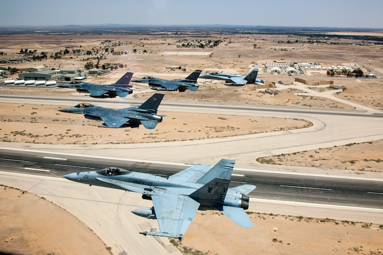 A Jordanian F-16 Fighting Falcon leads another Jordanian F-16, as well as an American F-16 from the120th Fighter Squadron, Colorado Air National Guard, and two Marine F-18's from VMFA-115 over a training base in Northern Jordan. These aircraft represent some of the assets involved in the Eager Lion Exercise being held in Jordan. Eager Lion is a U.S. Central Command-directed, irregular warfare-themed exercise focusing on missions the United States and its coalition partners might perform in support of global contingency operations. (U.S. Air National Guard photo by Senior Master Sgt. John P. Rohrer)