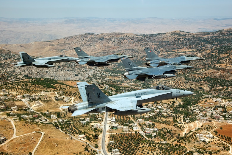 A Jordanian F-16 Fighting Falcon leads another Jordanian F-16, as well as an American F-16 from the120th Fighter Squadron, Colorado Air National Guard, and two Marine F-18's from VMFA-115 over the skies of Jordan. These aircraft represent some of the assets involved in the Eager Lion Exercise being held in Jordan. Eager Lion is a U.S. Central Command-directed, irregular warfare-themed exercise focusing on missions the United States and its coalition partners might perform in support of global contingency operations. (U.S. Air National Guard photo by Senior Master Sgt. John P. Rohrer)