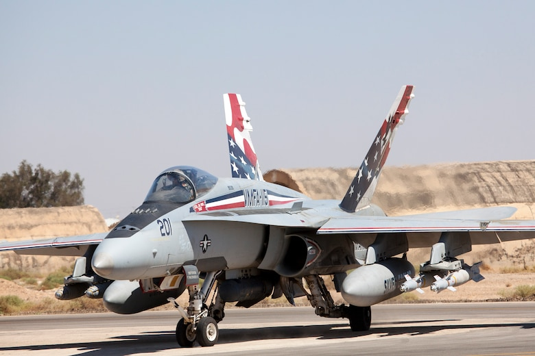 """A Marine F-18 Hornet taxis into position for takeoff at a training base in Northern Jordan as part of Exercise Eager Lion. The Marine jets will play """"aggressors"""" during air-to-air maneuvers that take place here as part of the ongoing training performed between the Americans and Jordanians. Eager Lion is a U.S. Central Command-directed, irregular warfare-themed exercise focusing on missions the United States and its coalition partners might perform in support of global contingency operations. (U.S. Air National Guard photo by Senior Master Sgt. John P. Rohrer)"""