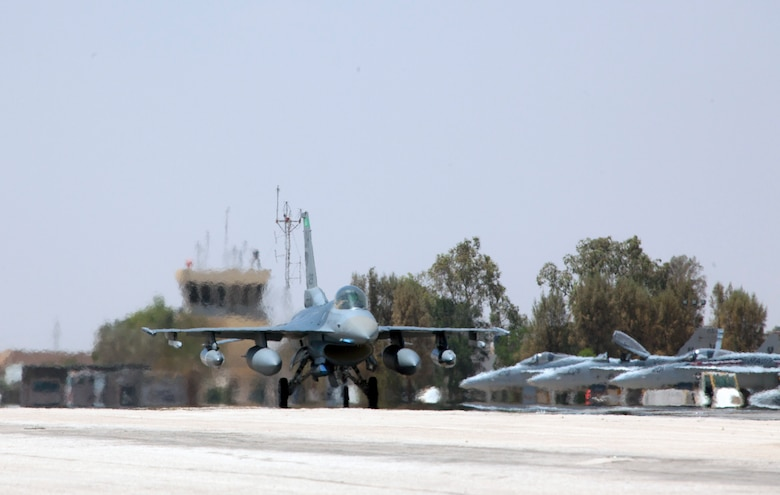 An F-16 Fighting Falcon from the 180th Fighter Wing, Ohio Air National Guard, taxis after arriving at a training base in Northern Jordan as part of Exercise Eager Lion. Eager Lion is a U.S. Central Command-directed, irregular warfare-themed exercise focusing on missions the United States and its coalition partners might perform in support of global contingency operations. (U.S. Air National Guard photo by Senior Master Sgt. John P. Rohrer)