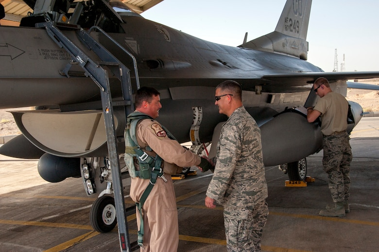 Col. Floyd Dunstan (right) greets Lt. Col. Patrick Hanlon, both from the Colorado Air National Guard, as he arrives at a training base in Northern Jordan as part of the Eager Lion exercise. Eager Lion is a U.S. Central Command-directed, irregular warfare-themed exercise focusing on missions the United States and its coalition partners might perform in support of global contingency operations. (U.S. Air National Guard photo by Senior Master Sgt. John P. Rohrer)