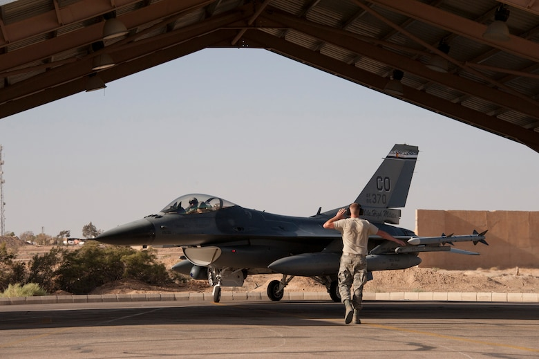 An F-16 Fighting Falcon from the Colorado Air National Guard prepares to park at a training base in Northern Jordan as part of the Eager Lion exercise. Eager Lion is a U.S. Central Command-directed, irregular warfare-themed exercise focusing on missions the United States and its coalition partners might perform in support of global contingency operations. (U.S. Air National Guard photo by Senior Master Sgt. John P. Rohrer)