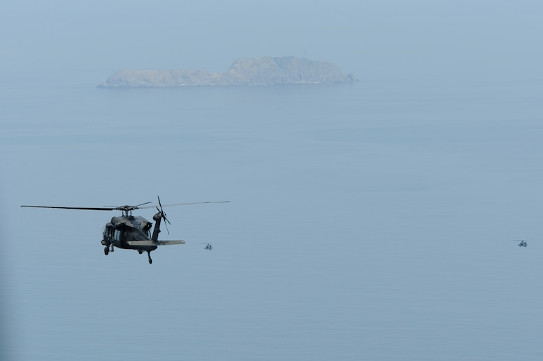 A U.S. Army UH-60 Black Hawk helicopter trails a pair of AH-64 Apache Longbow helicopters during a live-fire exercise at Jik-Do Island, Republic of Korea, June 7, 2013. The helicopters were assigned to the 4th Aerial Reconnaissance Battalion (Attack), 2nd Aviation Regiment, Camp Humphreys, ROK and staged out of Kunsan Air Base, ROK during their annual training. (U.S. Air Force photo/ Staff Sgt. Tong Duong/ Released)