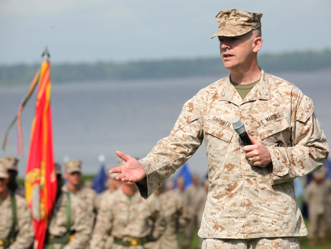 Lt. Col. Harry L. Gardner, the incoming commanding officer Headquarters and Support Battalion, speaks to guests during his change of command ceremony aboard Marine Corps Base Camp Lejeune June 21. Gardner deployed with Operation Desert Shield and Operation Desert Storm during which he received a purple heart for wounds received in action