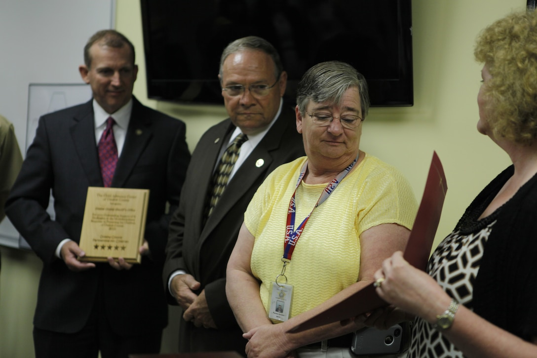 Captain Pam Sanders of the Onslow County Sheriff's Office was honored with the Champion of Children award at a recent regnition ceremony hosted by the Child Advocacy Center of Onslow County. Naval Criminal Investigative Services, Onslow County Sheriff's Office, Jacksonville Police Department, Onslow County Department of Social Services, Onslow County District Attorneys Office and the Guns-and-Hoses Comittee were also honored at the ceremony.