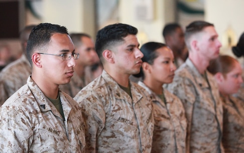 Marines with 1st Supply Battalion, Combat Logistics Regiment 15, 1st Marine Logistics Group, stand at attention during a capstone 
