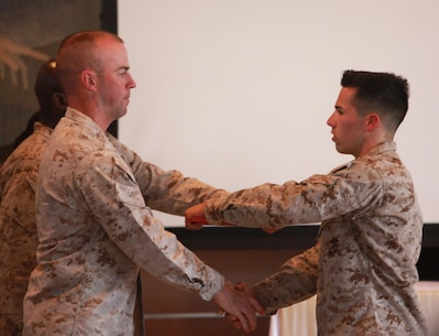Lieutenant Col. Michael J. Fitzgerald, left, commanding officer, 1st Supply Battalion, Combat Logistics Regiment 15, 1st Marine 