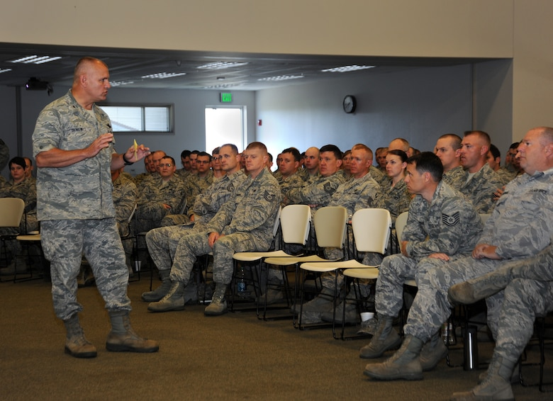 Oregon Air National Guard Col. Michael Bieniewicz, Oregon Combat Operations (COG) Commander greets Airmen at the start of a five-day joint training event at Camp Rilea, Ore., June 20, 2013. The COG is made up of the 123rd Weather Flight, 125th Special Tactic Squadron, 270th Air Traffic Control Squadron and the 116th Air Control Squadron. (Air National Guard photo by Tech. Sgt. John Hughel, 142nd Fighter Wing Public Affairs)