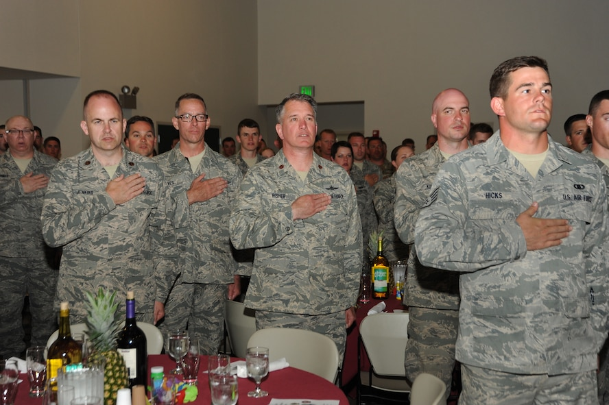 Oregon Airmen of the Combat Operations Group stand for the Pledge of Allegiance during a combat dinning-in event at Camp Rilea, Ore., June 22, 2013. (Air National Guard photo by Tech. Sgt. John Hughel, 142nd Fighter Wing Public Affairs)The training was held over a five-day period in which the Combat Operations Group (COG) made up of four individual Oregon Air Guard units; 125th STS, 116th ACS, 270th ATCS and the 123rd WF. The focus of the training was to build unit morale, establish new professional networks and enhance military development. (Air National Guard photo by Tech. Sgt. John Hughel, 142nd Fighter Wing Public Affairs)