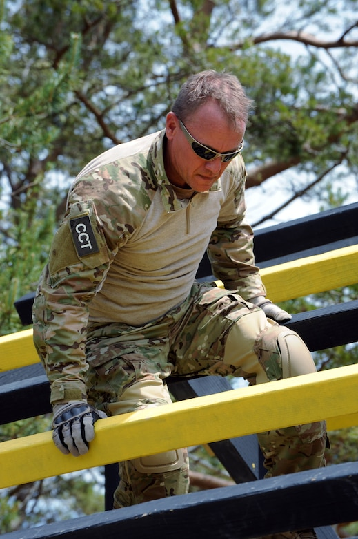 Air National Guard Capt. Scot Berg, 125th Special Tactics Squadron makes his way over an obstacle during the 'Monster Mash' training exercise, June 22, 2013 at Camp Rilea, Ore. The training was held over a five-day period in which the Combat Operations Group (COG) made up of four individual Oregon Air Guard units; 125th STS, 116th ACS, 270th ATCS and the 123rd WF. The focus of the training was to build unit morale, establish new professional networks and enhance military development. (Air National Guard photo by Tech. Sgt. John Hughel, 142nd Fighter Wing Public Affairs)