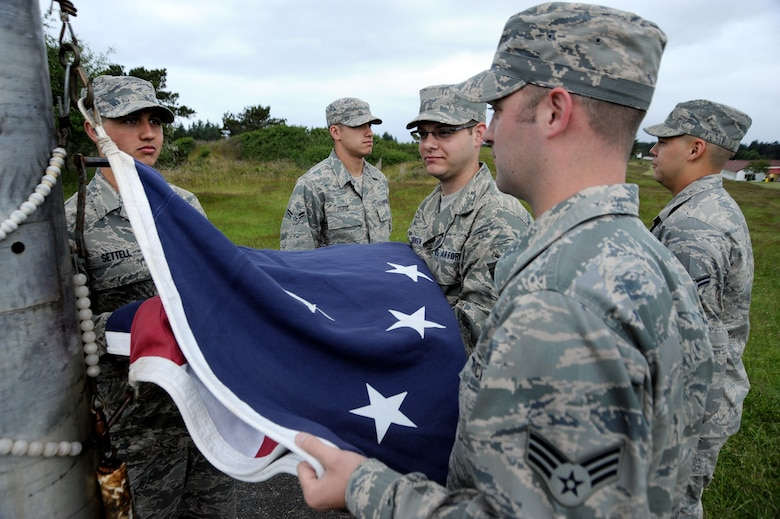 Airmen of the Combat Operations Group prepare to raise the colors during a morning reveille at Camp Rilea, Ore., June 21, 2013. (Air National Guard Photo by Tech. Sgt. John Hughel, 142nd Fighter Wing Public Affairs)