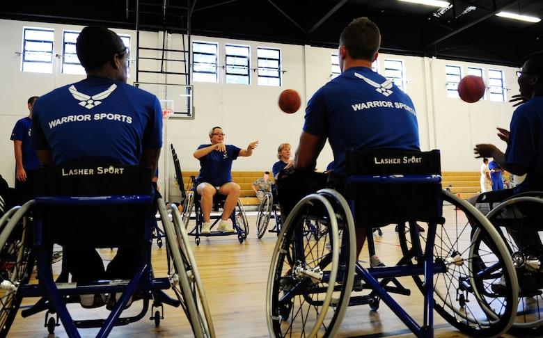 Wounded Warriors learn to play wheelchair basketball during an Air Force Wounded Warrior Adaptive Sports Training Camp at the West Fitness Center at Joint Base Andrews, Md., June 26, 2013. (U.S. Air Force photo/Senior Airman Lauren Main)