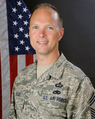 U.S. Air Force Chief Master Sgt. Ed Bruce, 245th Air Traffic Control Squadron at McEntire Joint National Guard Base, South Carolina Air National Guard, poses for his official portrait June 21, 2013.  (U.S. Air National Guard photo by Tech. Sgt. Caycee Watson/Released)
