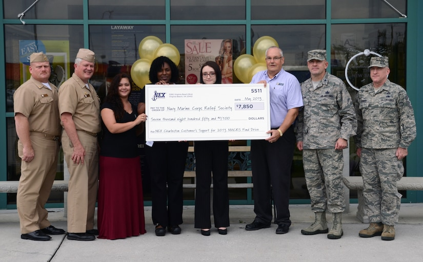 JOINT BASE CHARLESTON - WEAPONS STATION, S.C. — Joint Base Charleston Navy Exchange employees, along with JB Charleston leadership, present the local Navy and Marine Corps Relief Society a check in the amount of $7,850 for funds raised during the Spring 2013 NMCRS fund drive campaign June 20, 2013, at Joint Base Charleston – Weapons Station, S.C. Left to right: Master Chief Petty Officer Joseph Gardner, Naval Support Activity Charleston command master chief, Navy Capt. Thomas Bailey, JB Charleston deputy commander, NEX associates Leanne Elmhorst, Valerie Mabry and Kristina Nagel; David Hastings, Charleston NMCRS director, Col. Richard McComb, JB Charleston commander, and Chief Master Sgt. Earl Hannon, 628th Air Base Wing command chief. (U.S. Navy photo/ Petty Officer 1st Class Chad Hallford)
