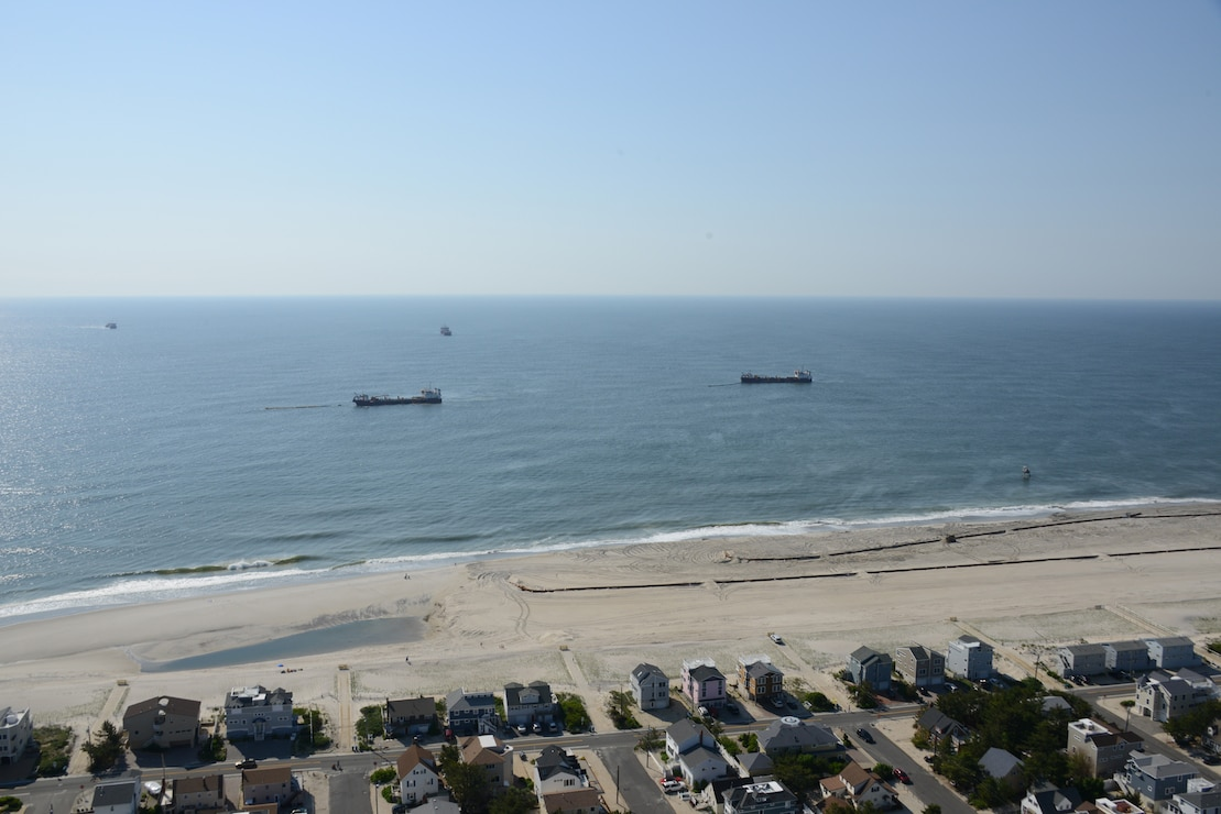 The Dredges Liberty Island, Dodge Island, Padre Island and Terrapin Island, of Great Lakes Dredge & Dock Company, pump sand onto Brant Beach, NJ in June of 2013.