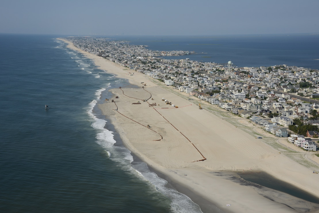 The U.S. Army Corps of Engineers Philadelphia District pumps sand onto Brant Beach, NJ in June of 2013 during a post-Sandy beachfill operations.