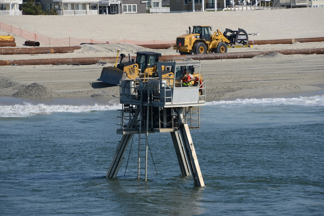 A Coastal Research Amphibious Buggy (CRAB) surveys the surf area of Brant Beach, NJ during beachfill operations in June 2013.