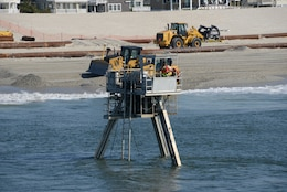 A Coastal Research Amphibious Buggy (CRAB) surveys the surf area of Brant Beach, NJ during a restoration project in June of 2013. The U.S. Army Corps of Engineers Philadelphia District is working to restore its Coastal Storm Risk Management project on Long Beach Island.