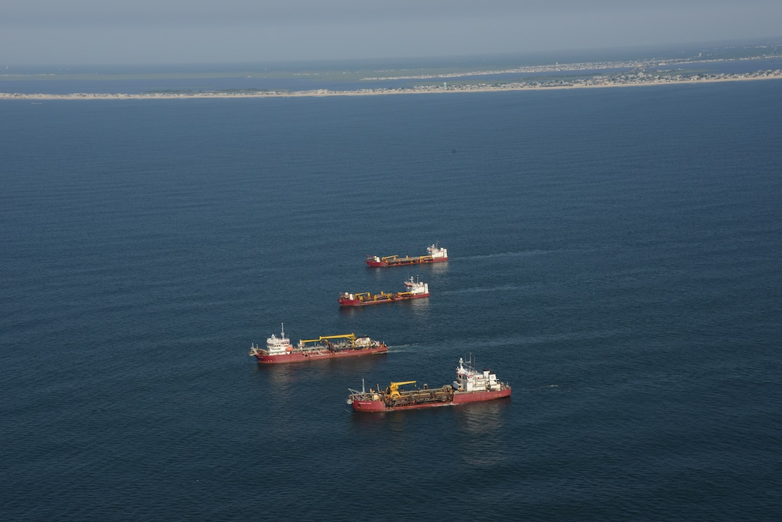 The Dredges Liberty Island (front), Dodge Island, Padre Island and Terrapin Island, of Great Lakes Dredge & Dock Company, transit offshore to dredge sand and pump it onto Long Beach Island, NJ in June of 2013.