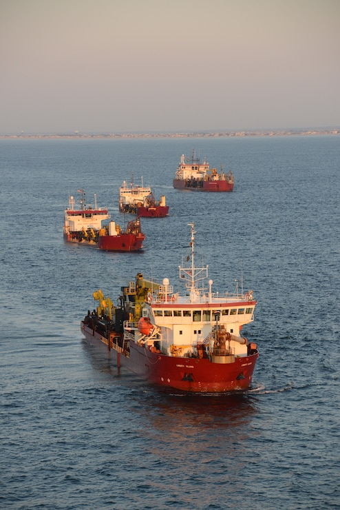 The Dredges Liberty Island (front), Dodge Island, Padre Island and Terrapin Island, of Great Lakes Dredge & Dock Company, transit offshore to dredge sand and pump it onto Long Beach Island, NJ in June 2013.