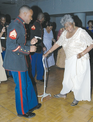 Marines participate in the Senior Prom held June 21 at the Albany James H. Gray Sr. Civic Center.