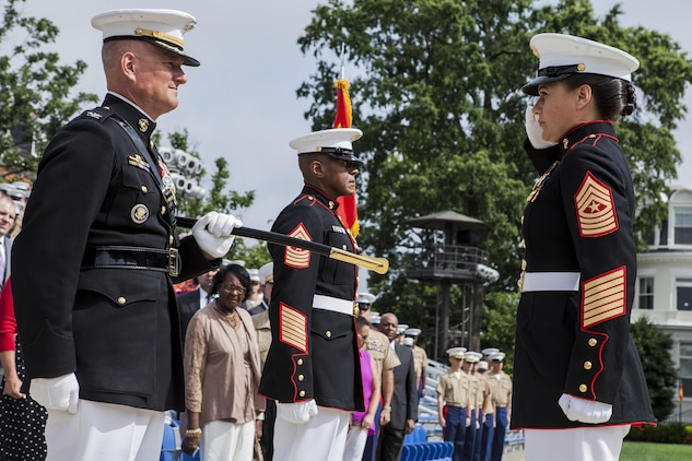 Sgt. Maj. Angela M. Maness, Marine Barracks Washington, D.C. sergeant major, right, salutes Col. Christian Cabaniss, the Barracks commanding officer, left, during a relief and appointment ceremony at the Barracks June 27, 2013. Maness assumed command of her post after relieving Sgt. Maj. Eric J. Stockton, former Barracks sergeant major. Stockton retired during the ceremony, after more than 30 years of service.