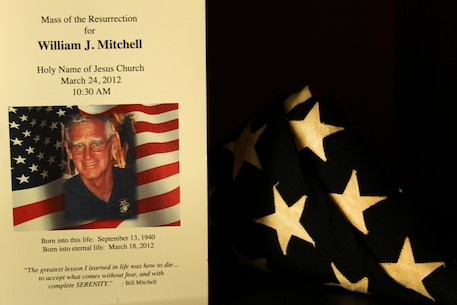 A program from William J. Mitchell's funeral service sits on a Blake family shelf on June 19, 2013. Mitchell, Marine Pfc. Scott A. Blake's grandfather, dedicated several years of service to the development of the Library of the Marine Corps located in the Alfred M. Gray Research Center at Marine Corps Base Quantico, Va. (Marine Corps photo by Sgt. Aaron Rooks)