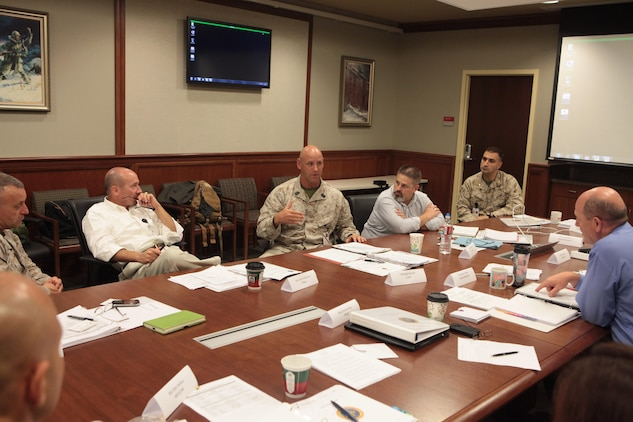 Master Gunnery Sgt. Matthew C. Becker, I Marine Expeditionary Force, Anti- Terrorism Force Protection chief and Defense Support of Civil Authorities lead, discusses operations and techniques with a collection of representatives from major U.S. Marine Corps Headquarters based in the U.S. at the Marine Forces Reserve and Marine Forces North headquarters, during the first Marine Corps led DSCA working group, June 20. The Marines and civilians gathered to discuss and synchronize each section's disaster response efforts and capabilities, review current operational requirements and prepare for the upcoming hurricane and wildland fire season. (Official U.S. Marine Corps photo by Cpl. Fenton Reese)