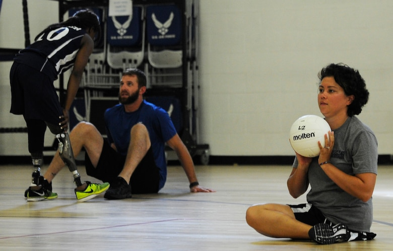 Capt. Sarah Evans, 59th Medical Wing patient learns the fundamentals of sitting volleyball at an Air Force Wounded Warrior Sports Camp Clinic at the Joint Base Andrews West Fitness Center, Md., June 27, 2013.  More than 30 Air Force Wounded Warriors attended the two-day adaptive sports camp of wheelchair basketball, sitting volleyball, archery, swimming, air rifle/pistol shooting and track and field, designed to help them overcome their challenges and enjoy a physically active lifestyle. (U.S. Air Force photo/Airman 1st Class Nesha Humes)