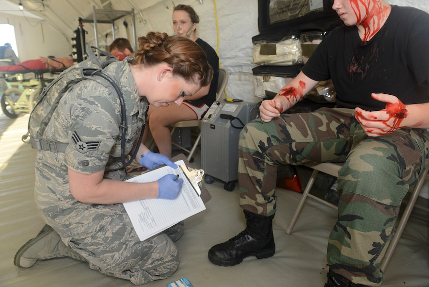 U.S. Air National Guard Senior Airman Jamison Tolbert, medical technician, 136th Medical Group, records casualty information during a mass casualty exercise at Naval Air Station Fort Worth, Joint Reserve Base, Texas, June 23, 2013. The mass casualty exercise is conducted annually to assess the readiness of the 136th Medical Group's ability to engage in actual disaster relief. (Air National Guard photo by Master Sgt. Charles Hatton/released)