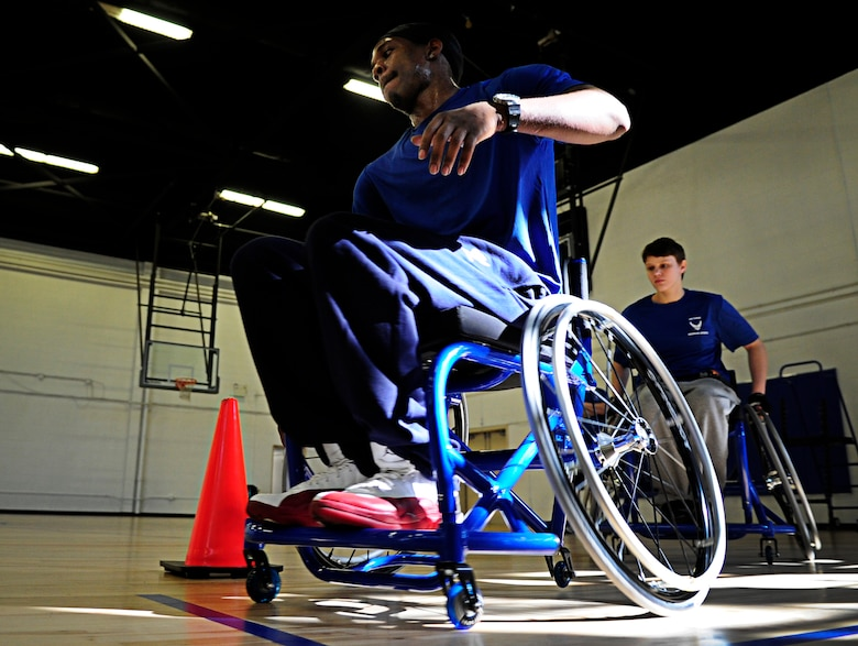 Wounded Warriors learn to maneuver through cones in a wheelchair before playing a game of wheelchair basketball during an Air Force Wounded Warrior Adaptive Sports Training Camp at the West Fitness Center at Joint Base Andrews, Md., June 26, 2013. (U.S. Air Force photo/Senior Airman Lauren Main)