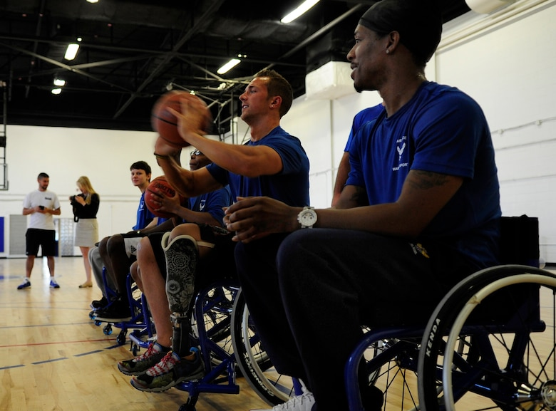 Wounded Warriors learn the fundamentals of wheelchair  basketball prior to playing a game during an Air Force Wounded Warrior Adaptive Sports Training Camp at the West Fitness Center at Joint Base Andrews, Md., June 26, 2013. (U.S. Air Force photo/Senior Airman Lauren Main)