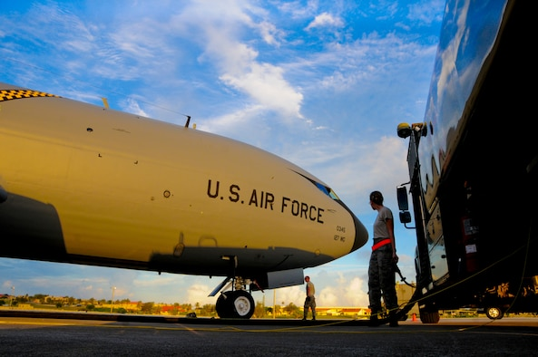 Airman 1st Class Ashley Lee, 36th Logistics Readiness Squadron fuels distribution operator, helps maintainers refuel a KC-135 Stratotanker, June 26, 2013, on Andersen Air Force Base, Guam. (U.S. Air Force photo by Airman 1st Class Marianique Santos/Released)
