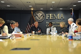 FEMA Administrator Craig Fugate (left), USACE Commanding General Lt. Gen. Thomas Bostick (right) engage participants in the 2013 Senior Leaders Seminar discussions.
