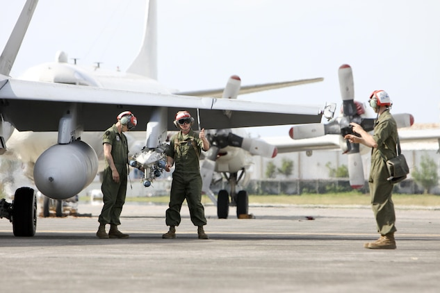 Lance Cpl. John T. Page, right, gives orders through hand and arms signals to Sgt. Ian R. Wheeler, left, and Lance Cpl. William F. Burch to arm an F/A-18D Hornet for flight at Clark Air Base, Republic of the Philippines, June 11 during Exercise Haribon Tempest 2013. All three Marines are aircraft ordnance technicians with Marine All-Weather Fighter Attack Squadron 242.