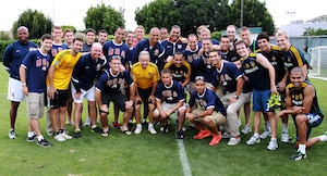 The military Team USA meets with some of the Los Angeles Galaxy coaches and players after observing one of their practices at the Stub Hub Stadium in Los Angeles June 25. The military Team USA is made up of Soldiers, Sailors, Airmen, and Marines from all over the world. Team USA is scheduled to play in the 1st Annual Military World Cup held in Baku, Azerbaijan. The LA Galaxy invited Team USA to watch and learn from their practice time.