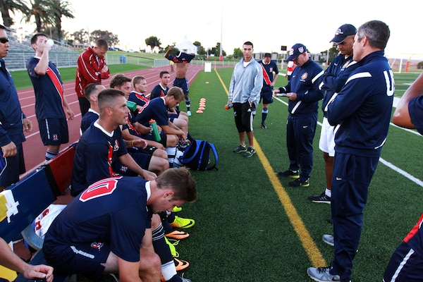Team USA Armed Forces players sit on the bench as the coaches go over the first half of their game against Bethesda University held at the 11-area field here June 24.Team USA Armed Forces won 5-1 after 90 minutes of play. Team USA Armed Forces is scheduled to play in the 1st Annual Military World Cup held in Baku, Azerbaijan.