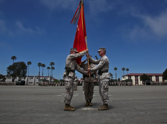 Lieutenant Col. John O'Neal assumed command of the 15th Marine Expeditionary Unit from Col. Scott D. Campbell during a change of command ceremony aboard the Camp Del Mar parade deck, June 27.