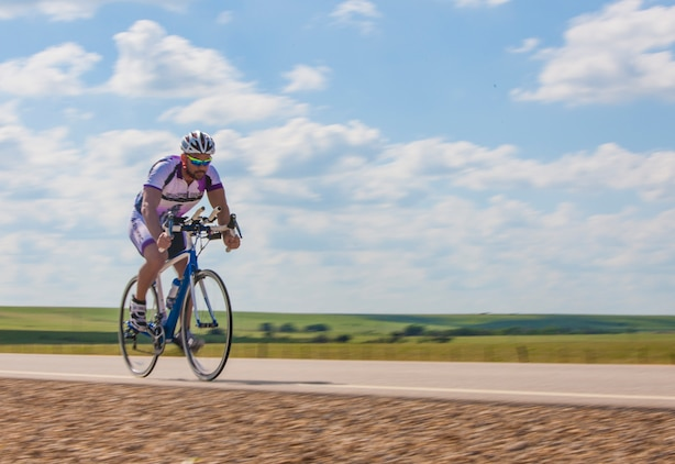 Keola Dietz, a cyclists and wounded warrior with Team Walter Reed Bethesda from Kaneohe, Hawaii, cycles through the unforgiving heat of Arizona during the 32nd Annual Race Across America, June 19. Team Walter Reed Bethesda is comprised of all wounded warriors that were treated at Walter Reed Hospital in Bethesda, Md.
