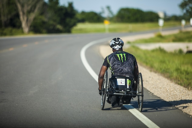 Anthony Robinson, a cyclists and wounded warrior with Team Walter Reed Bethesda from Baton Rouge, La., cycles through the west during the 32nd Annual Race Across America, June 18. Team Walter Reed Bethesda was formed to help wounded veterans rebuild themselves and regain their warrior spirits.