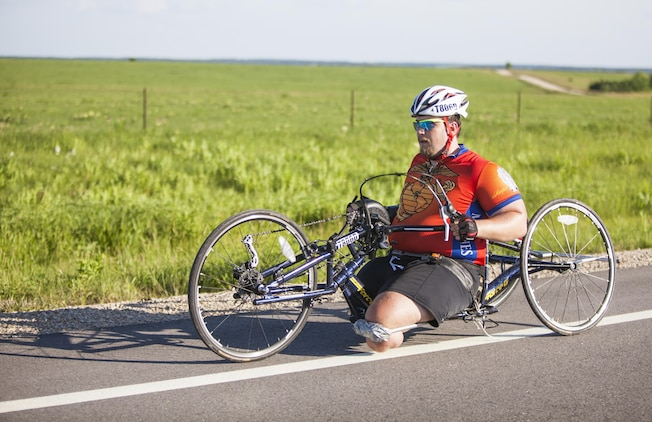 Michael Frazier, a cyclists and wounded warrior with Team Walter Reed Bethesda from Lower Burrell, Penn., cycles for during the 32nd Annual Race Across America, June 19. Michael Frazier joined Team Walter Reed Bethesda to face a new challenge with fellow wounded warriors.