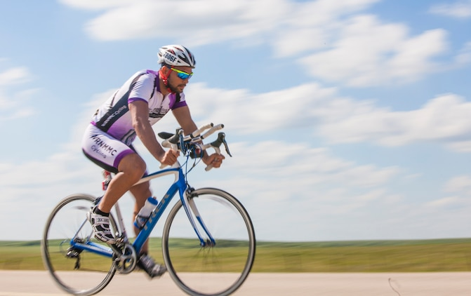 Keola Dietz, a cyclists and wounded warrior with Team Walter Reed Bethesda from Kaneohe, Hawaii, races across the 3,000 mile course of the 32nd Annual Race Across America, June 19. Team Walter Reed Bethesda is comprised of all wounded warriors that were treated at Walter Reed Hospital in Bethesda, Md.
