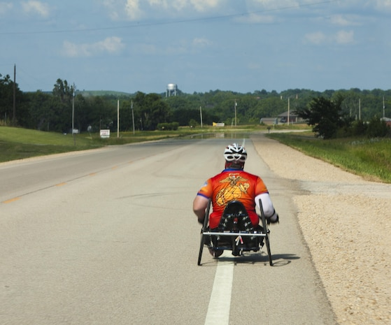 Michael Frazier, a cyclists and wounded warrior with Team Walter Reed Bethesda from Lower Burrell, Penn., cycles during the 32nd Annual Race Across America, June 19. Michael Frazier joined Team Walter Reed Bethesda to face a new challenge with fellow wounded warriors.