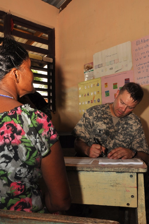 U.S. Army 1st Lt. Jason Stahl, Joint Task Force-Bravo Medical Element registered nurse, speaks to a villager about her alignments, during a medical readiness training exercise held in the remote region of Bara Patuca, Gracias a Dios, June 25-26, 2013. During the two-day exercise the medical team visited with more than 910 patients with alignments ranging from a common cold to pneumonia.