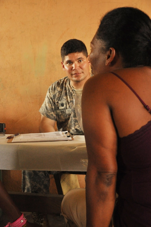 U.S. Army Lt. Col. (Doctor) Bart Diaz, Joint Task Force- Bravo Medical Element commander, speaks to a villager about her medical issues during a medical readiness training exercise held in the remote region of Bara Patuca , Gracias a Dios, June 25-26, 2013. During the two-day exercise the medical team visited with more than 910 patients to various patients with alignments ranging from a common cold to pneumonia.