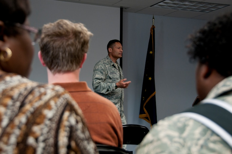 JOINT BASE ELMENDORF-RICHARDSON, Alaska -- Alaska air guardsmen recieve a deployment briefing before they say farewell to their friends, families and coworkers here June 26, 2013, before they leave on deployment. Nearly 100 air guardsmen from across the 176 Wing, mostly from the 176 Maintenance Group and 176 Operations Group, left for Kuwait this week in support of Operation Enduring Freedom. National Guard photo by Staff Sgt. N. Alicia Halla.