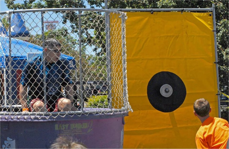"""152AW CC Col. Burkett preparing to be """"dunked"""" again during the Nevada National Guard's """"Family Day"""" on Saturday, 22 June at the Air Base in Reno.  More than 2,000 Airmen, friends and family members attended the event.  NV ANG photo by Capt. Jason Yuhasz 152AW/PA (released)."""
