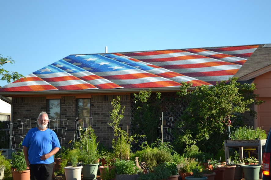 Edwin Kincaid, a subject matter expert technical lead within the Air Force Sustainment Center Engineering Directorate, said he and his wife, Edith, were honored to represent Moore when an artist from New York asked to paint a flag on their roof. (Air Force photo by April McDonald)