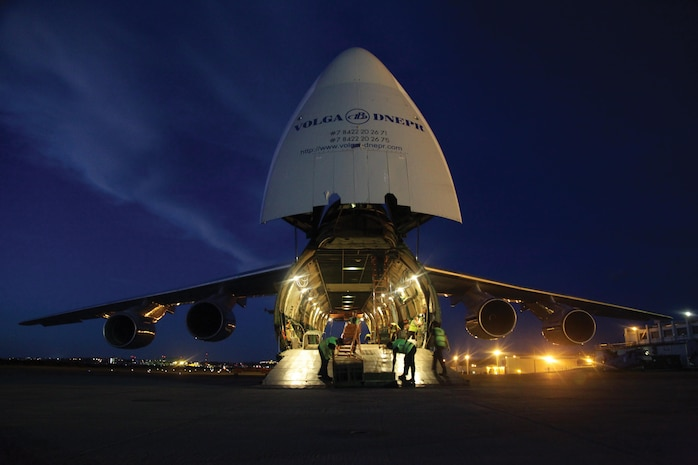 The crew of an Antonov An-124 cargo aircraft prepares to load three CH-46E Sea Knight helicopters June 17 at Marine Corps Air Station Futenma. The CH-46Es are assigned to Marine Medium Helicopter Squadron 262, Marine Aircraft Group 36, 1st Marine Aircraft Wing, III Marine Expeditionary Force. The crew and cargo aircraft are with a Russian Federation contractor. Photo by Lance Cpl. Natalie M. Rostran